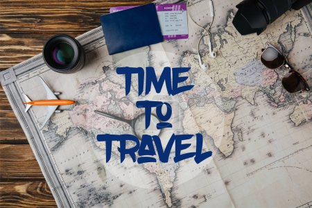 top view of magnifying glass, small model plane, sunglasses, photo camera, lens and passport with boarding pass on map with time to travel illustration