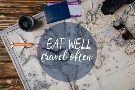 top view of magnifying glass, small model plane, sunglasses, photo camera, lens and passport with boarding pass on map with eat well, travel often illustration