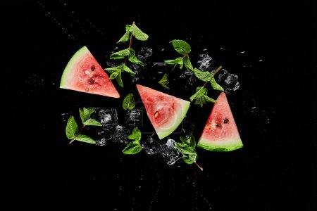 Photo for Top view of red watermelon slices with mint and ice isolated on black - Royalty Free Image