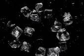 """Постер, картина, фотообои """"верхний вид плавления прозрачных освежающих кубиков льда, изолированных на черном"""""""
