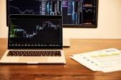 "Постер, картина, фотообои ""laptop and computer with charts and graphs, documents on table """
