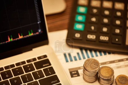 Photo for Selective focus of laptop, coins, papers and calculator on table - Royalty Free Image