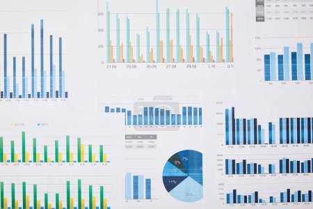 Photo for Top view of papers with charts and graphs on table - Royalty Free Image