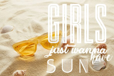 yellow stylish sunglasses on sand with seashells and girls just wanna have sun lettering