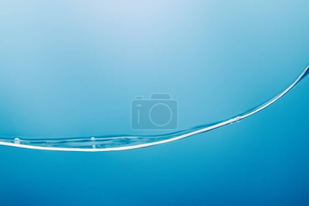smooth transparent pure water wave on blue background