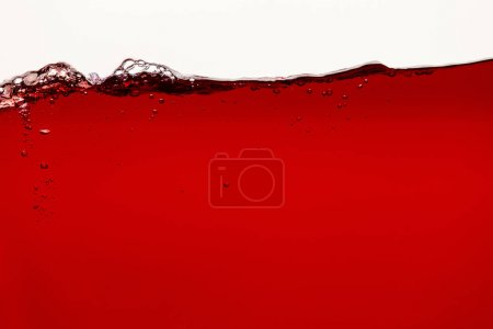Photo for Ripple red bright liquid with bubbles isolated on white - Royalty Free Image
