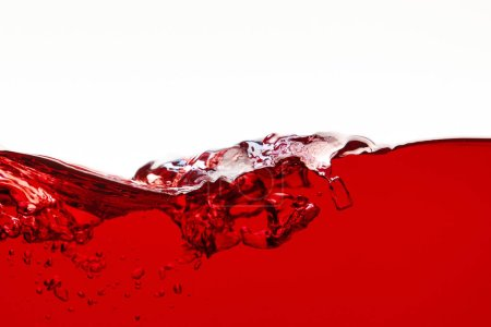 red bright liquid with splash isolated on white