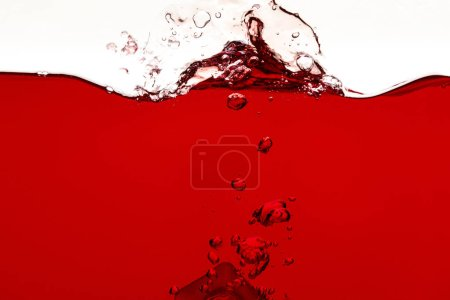 red liquid with splash and bubbles isolated on white