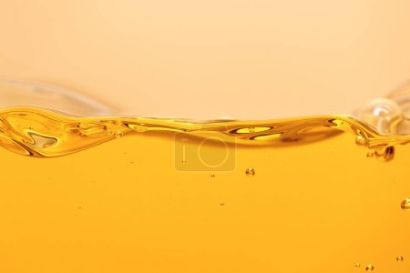 yellow bright liquid with bubbles isolated on yellow