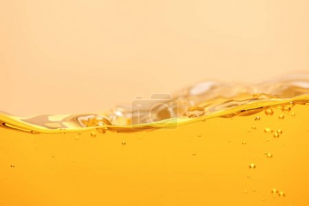 ripple yellow bright liquid with bubbles isolated on yellow