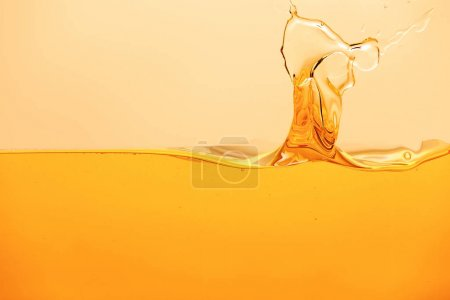 yellow bright liquid with splash isolated on yellow