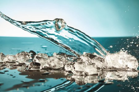 transparent ice cubes and water splash on emerald and white background