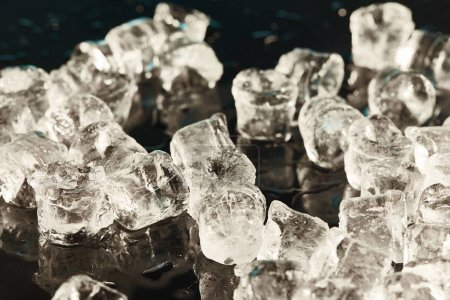 Photo for Transparent cool ice cubes on black background with water drops - Royalty Free Image