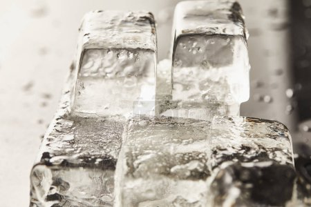 close up view of transparent wet textured ice cubes