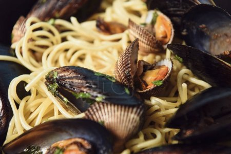 Photo for Close up view of delicious Italian pasta with mollusks and mussels - Royalty Free Image