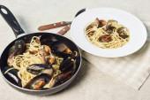 "Постер, картина, фотообои ""italian delicious pasta with seafood on textured grey background"""