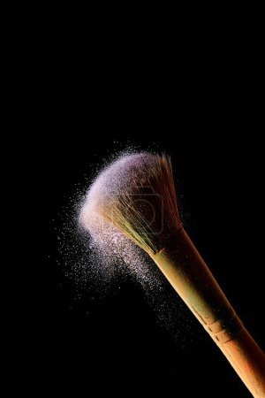 Photo for Cosmetic brush with colorful violet powder on black background - Royalty Free Image