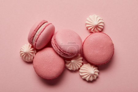 Photo for Pink macaroons with pink meringues on pink background - Royalty Free Image
