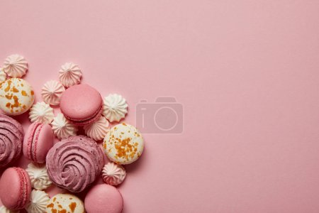 Photo for Delicious sweet pink and white macaroons with meringues on pink background - Royalty Free Image