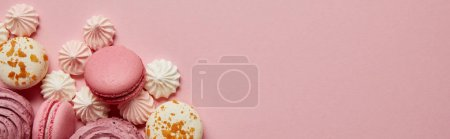 Photo for Top view of gourmet pink macaroons, assorted meringues and soft zephyr on pink background - Royalty Free Image
