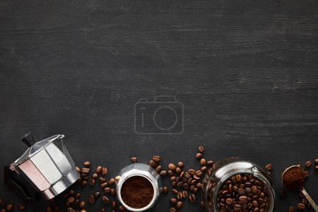 Photo for Top view of parts of geyser coffee maker near glass jar and spoon on dark wooden surface with coffee beans - Royalty Free Image