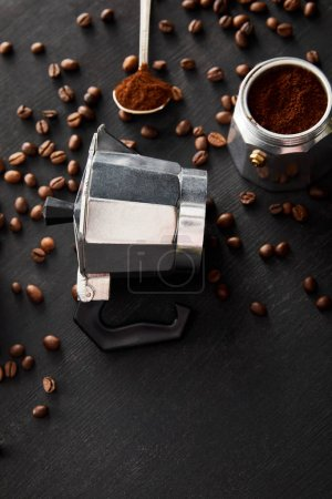 Photo for Separated parts of geyser coffee maker near spoon on dark wooden surface with coffee beans - Royalty Free Image