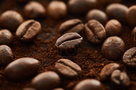 Aromatic brown coffee beans mixed with ground coffee