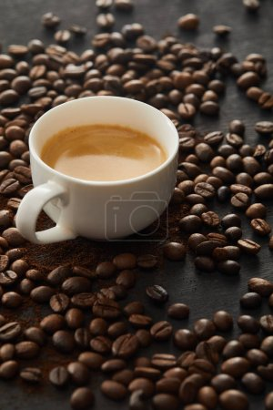 Photo for White cup with espresso on dark surface with coffee beans - Royalty Free Image