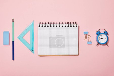 Photo for Flat lay with school supplies near blank notebook isolated on pink - Royalty Free Image