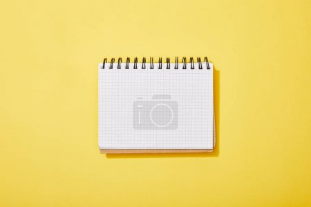 Photo for Top view of blank white notebook on yellow background - Royalty Free Image