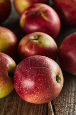 Photo for Red juicy apples on brown wooden surface - Royalty Free Image
