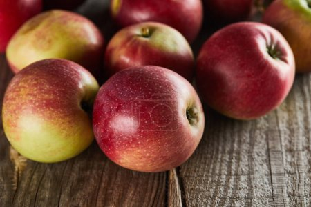 Photo for Ripe juicy apples on brown wooden surface - Royalty Free Image