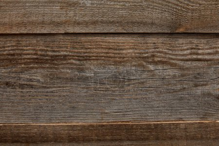 top view of weathered brown textured wooden background