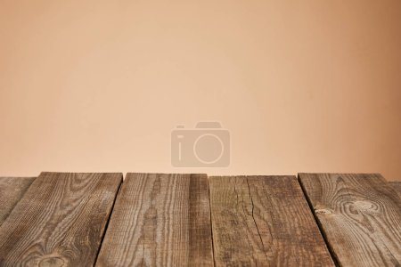 empty rustic wooden table isolated on brown