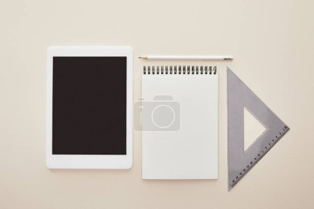 Photo for Top view of digital tablet with blank screen near notebook isolated on beige - Royalty Free Image