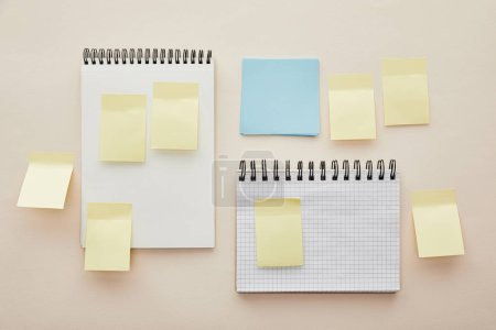 Photo for Top view of blank sticky notes on notebooks isolated on beige - Royalty Free Image