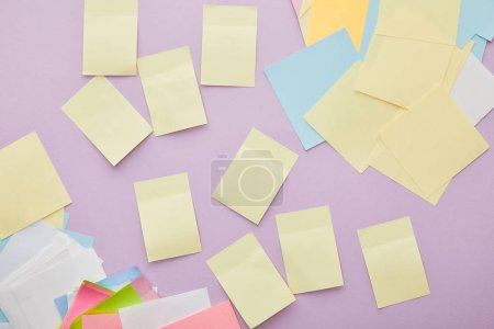 Photo for Top view of colorful sticky notes isolated on purple - Royalty Free Image