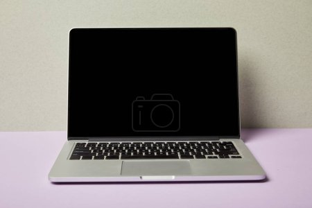 Photo for Laptop with blank screen on purple and grey - Royalty Free Image