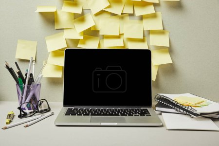Photo for Laptop with blank screen near empty sticky notes and stationery on grey and white - Royalty Free Image
