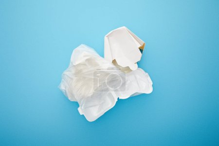 Photo for Top view of plastic bag with disposable containers on blue background - Royalty Free Image