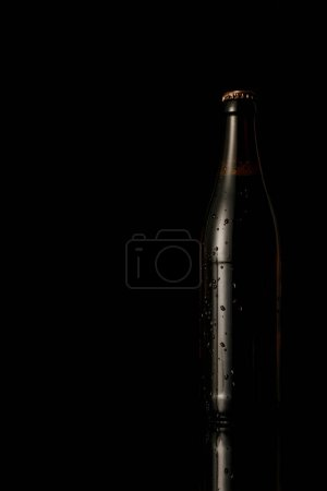 Photo for Glass bottle of beer with water drops isolated on black - Royalty Free Image