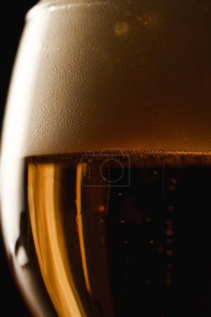 Photo for Close up view of beer with foam isolated on black - Royalty Free Image