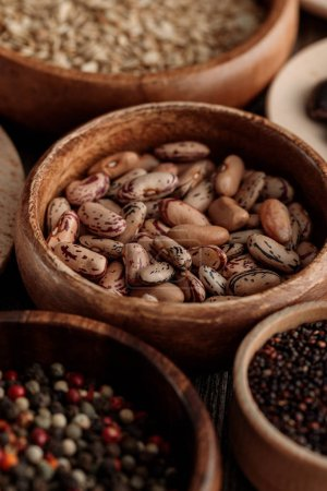 Photo for Close up view of wooden bowls with beans, grains and peppercorns - Royalty Free Image