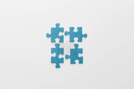 Photo for Top view of pieces of blue jigsaw puzzle on white background - Royalty Free Image