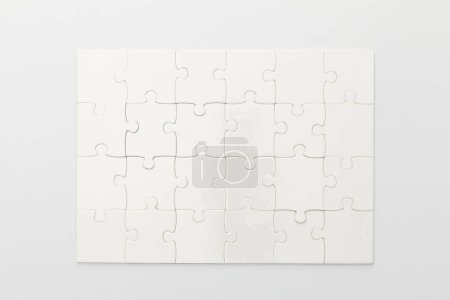 top view of completed jigsaw puzzle on white background