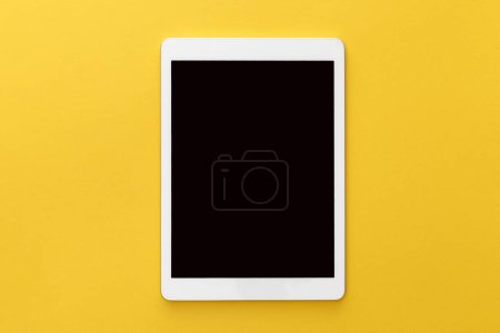 Photo for Top view of digital tablet with blank screen on yellow background - Royalty Free Image