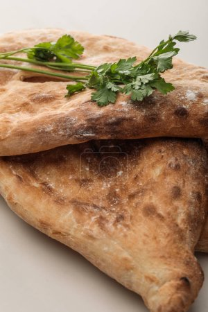 Photo for Lavash bread with fresh greenery on white surface - Royalty Free Image
