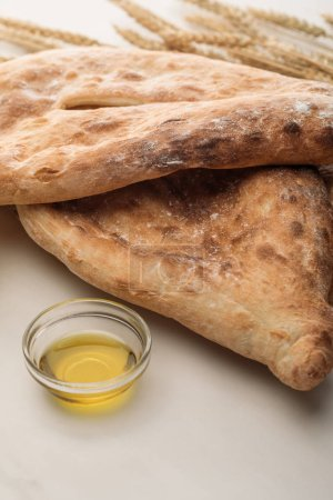 Photo for Lavash bread with folive oil on white surface - Royalty Free Image