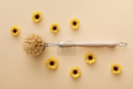 Photo for Top view of body brush on beige background with flowers - Royalty Free Image