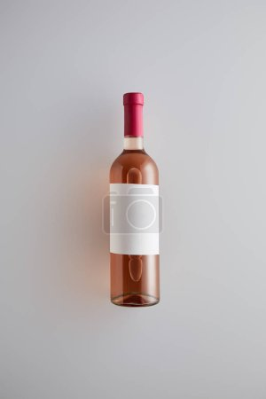Photo for Top view of bottle with rose wine and blank label on white background - Royalty Free Image
